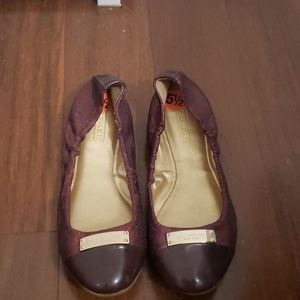 Red sparkling Coach flats